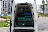 A van is loaded with boxes of food to be distributed to community centres and food waste projects
